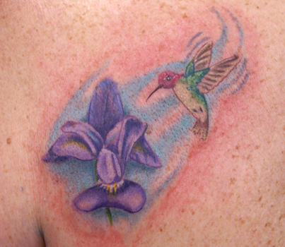 tattoo of a hummingbird tattoo of a dragon