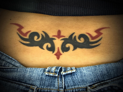 back tribal tattoos. hairstyles Lower Back Tattoo